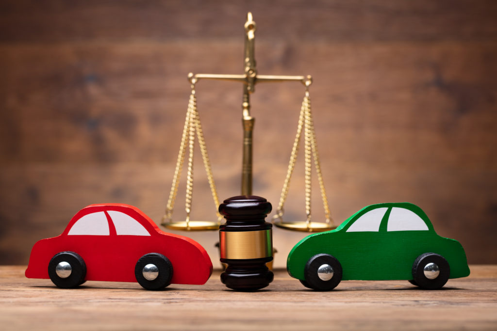 two toy cars and a scale
