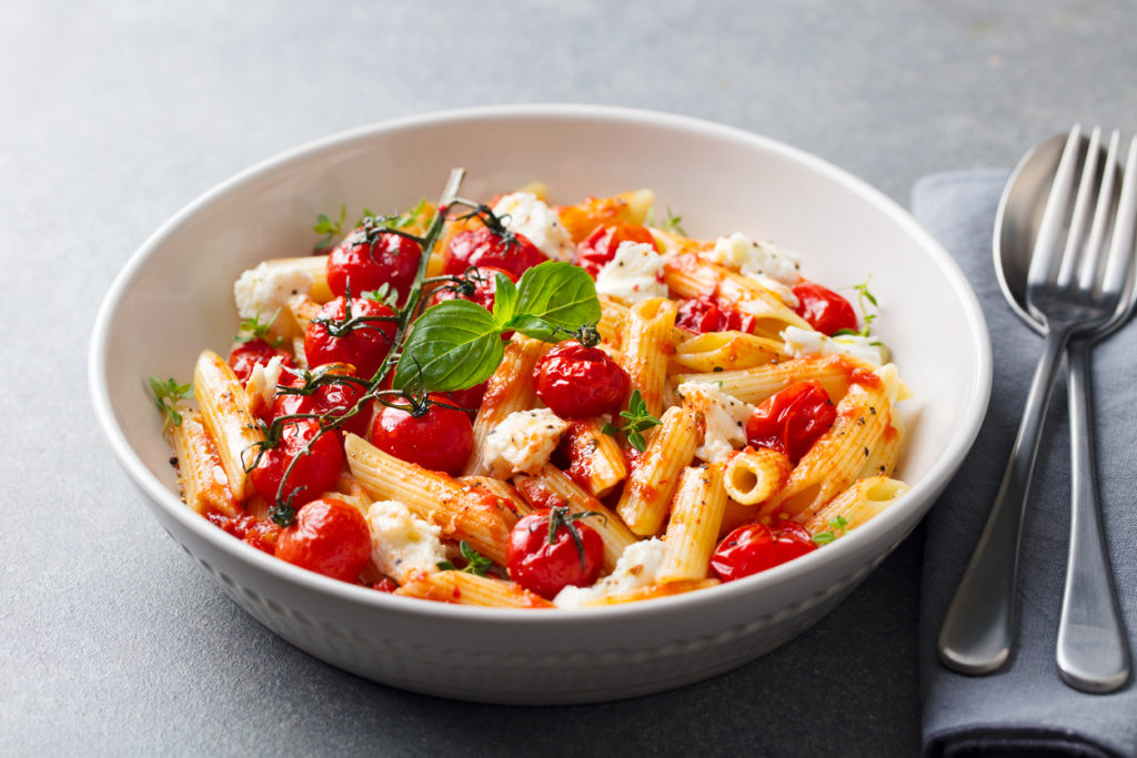 Pasta penne with roasted tomato, sauce, mozzarella cheese.