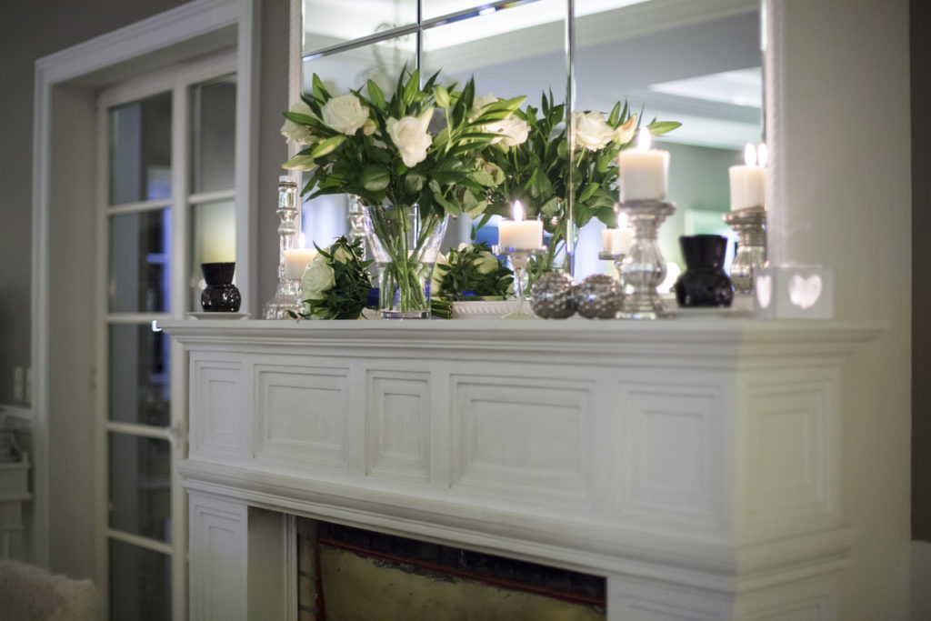 Flowers on a marble fireplace mantel