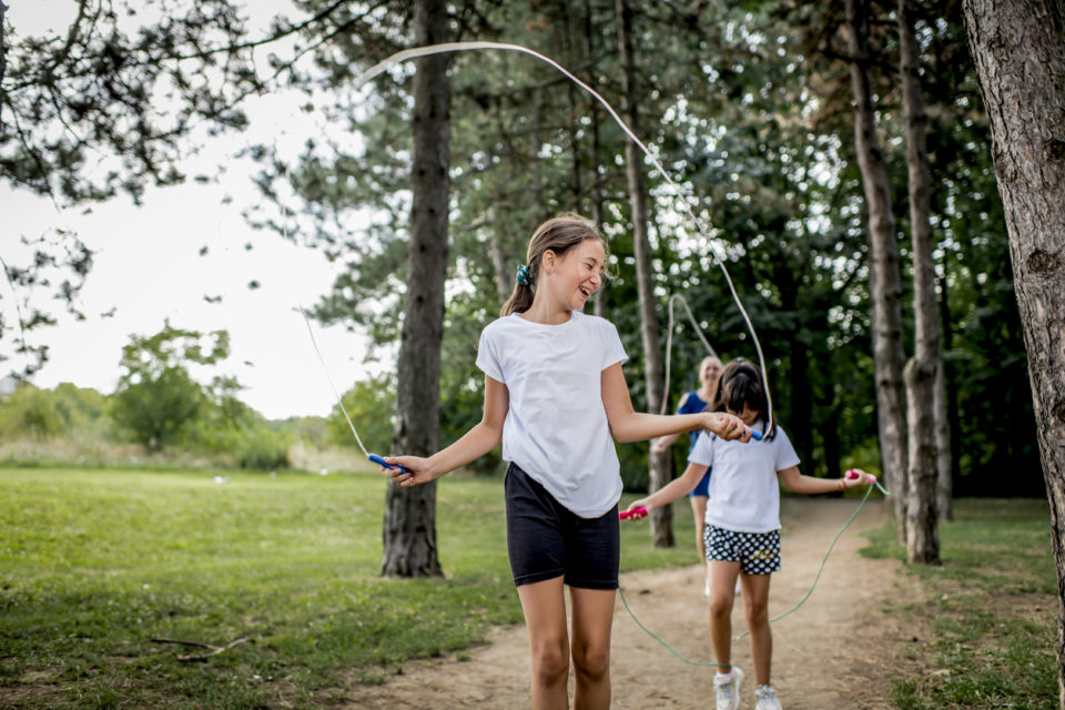 Kids jumping rope in the park